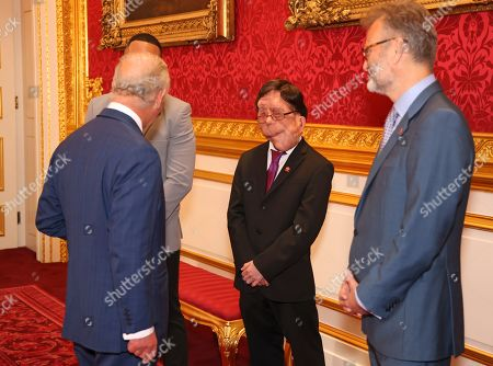 Prince Charles meets Adam Pearson and Hugh Dennis during the Prince's Trust Awards Trophy Ceremony at St James Palace on October 21, 2021 in London, England. The Prince's Trust Awards recognize young people who have succeeded against the odds, improved their chances in life and had a positive impact on their local community.