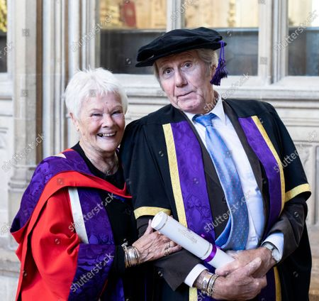Stock Photo of David Mills who received an Honorary Fellowship from the University of Winchester was joined by his partner Judi Dench, who received an Honorary Doctorate in 2019 also from Winchester University, at the ceremony at Winchester Cathedral today.