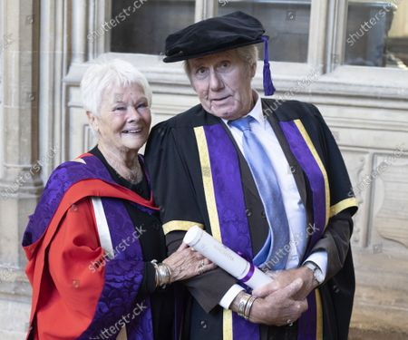 Stock Picture of David Mills who received an Honorary Fellowship from the University of Winchester was joined by his partner Judi Dench, who received an Honorary Doctorate in 2019 also from Winchester University, at the ceremony at Winchester Cathedral today.