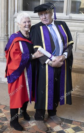 Stock Image of David Mills who received an Honorary Fellowship from the University of Winchester was joined by his partner Judi Dench, who received an Honorary Doctorate in 2019 also from Winchester University, at the ceremony at Winchester Cathedral today.