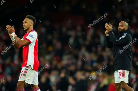 Pierre-Emerick Aubameyang and Alexandre Lacazette of Arsenal applaud the fans at full time