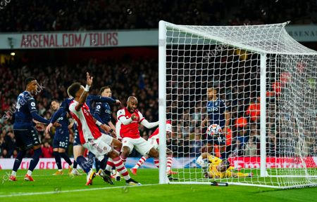 Stock Image of Alexandre Lacazette of Arsenal celebrates the opening goal scores by Thomas Partey as Aston Villa Goalkeeper Emiliano Martinez look towards the ball in vain