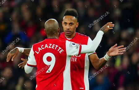 Stock Picture of Pierre-Emerick Aubameyang hugs Alexandre Lacazette of Arsenal