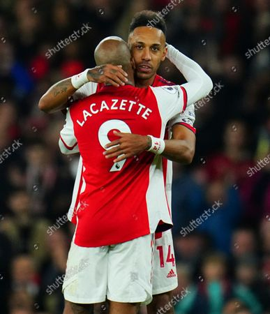 Pierre-Emerick Aubameyang hugs Alexandre Lacazette of Arsenal