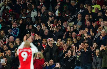 Home fans applaud Alexandre Lacazette of Arsenal