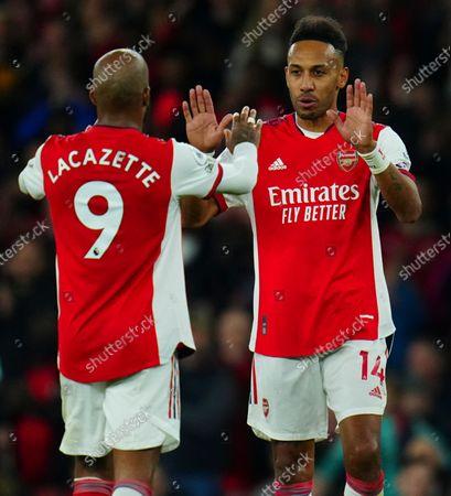 Pierre-Emerick Aubameyang high tens Alexandre Lacazette of Arsenal
