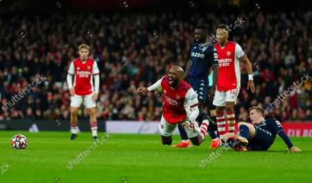 Matt Targett of Aston Villa fouls Alexandre Lacazette of Arsenal for a penalty which was given after a VAR check be referee Craig Pawson