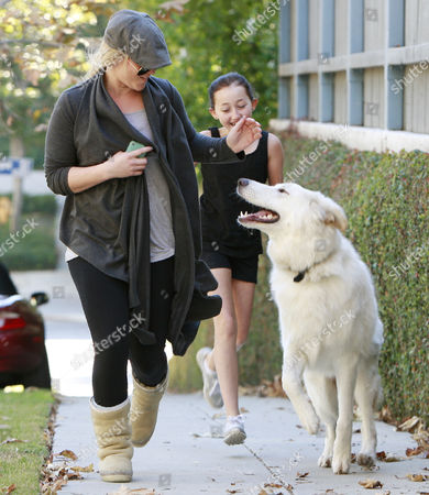 Stock Picture of Noah Cyrus with her dog Sophie