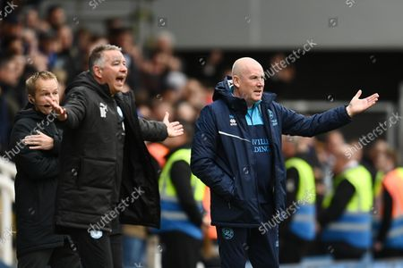 Stock Picture of Mark Warburton manager of Queens Park Rangers and Darren Ferguson manager of Peterborough United react.