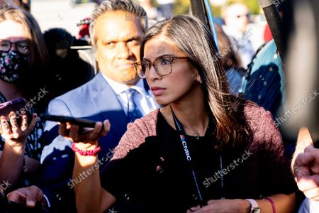 Stock Image of Reporter Ylan Mui listens to Rep. Richard Neal, D-Mass., as he speaks to reporters after the House votes to hold former White House Senior Adviser Steve Bannon in contempt of Congress after he defies a subpoena from a House panel on Jan. 6th, at the Capitol in Washington