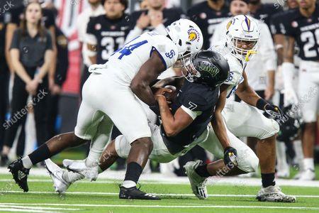 UNLV Rebels quarterback Cameron Friel (7) is tackled by San Jose State Spartans linebacker Jordan Cobbs (44) during the NCAA football game featuring the San Jose State Spartans and the UNLV Rebels at Allegiant Stadium in Las Vegas, NV. The San Jose State Spartans defeated the UNLV Rebels 27 to 20