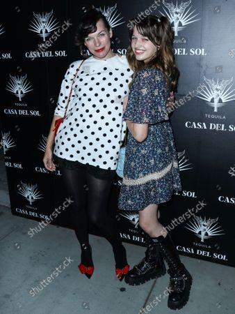 Actress Milla Jovovich and daughter/actress Ever Gabo arrive at Brian Bowen Smith's Drivebys Book Launch And Gallery Viewing Presented By Casa Del Sol Tequila held at 8175 Melrose Ave on October 21, 2021 in Los Angeles, California, United States.
