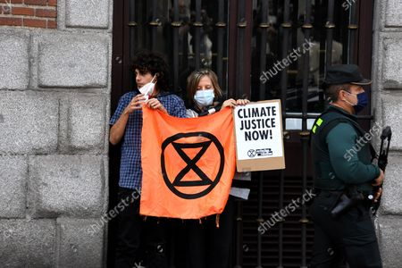 Stock Picture of Extinction Rebellion activists chain themselves to fence in latest protest in the Ministry of Foreign affairs in Madrid on 21st October, 2021.