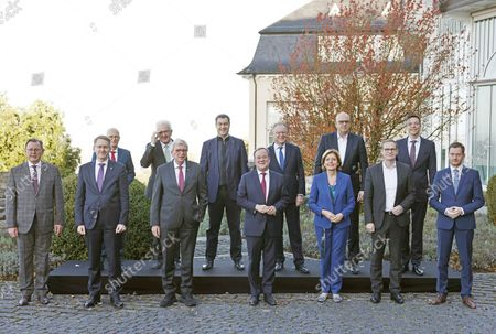 German federal states prime ministers (back row L-R) Peter Tschentscher (Hamburg), Winfried Kretschmann (Baden-Wuerttemberg), Markus Soeder (Bavaria), Stephan Weil (Lower Saxony), Andreas Bovenschulte (Bremen), Tobias Hans (Saarland), (front row L-R) Bodo Ramelow (Thuringia), Daniel Guenther (Schleswig-Holstein), Volker Bouffier (Hesse), Armin Laschet (North-Rhine Westfalia), Malu Dreyer (Rhineland-Palatinate), Michael Mueller (Berlin) and Michael Kretschmer (Saxony) pose for a family photo in Koenigswinter, Germany, 22 October 2021. The annual conference of the heads of states (MPK) meets for two-day deliberations.