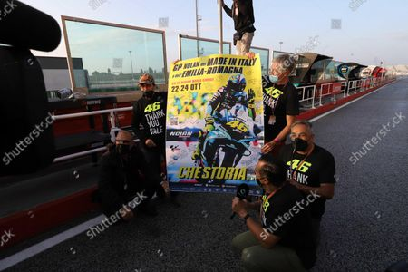 Valentino Rossi (C) of Petronas Yamaha SRT poses with the official poster of the Motorcycling Grand Prix of Italy and Emilia-Romagna at Misano World Circuit 'Marco Simoncelli' at Misano Adriatico, Rivieria di Rimini, Italy, 22 October 2021. The Motorcycling Grand Prix of Italy and Emilia-Romagna takes place on 24 October 2021.