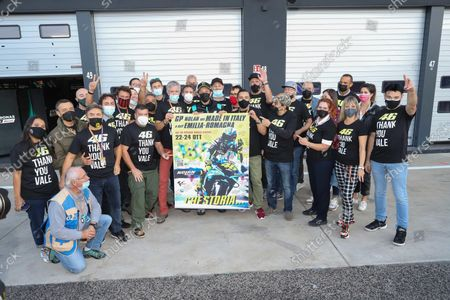 Valentino Rossi (C) of Petronas Yamaha SRT poses with the official poster of the Motorcycling Grand Prix of Italy and Emilia-Romagna and members of the media at Misano World Circuit 'Marco Simoncelli' at Misano Adriatico, Rivieria di Rimini, Italy, 22 October 2021. The Motorcycling Grand Prix of Italy and Emilia-Romagna takes place on 24 October 2021.