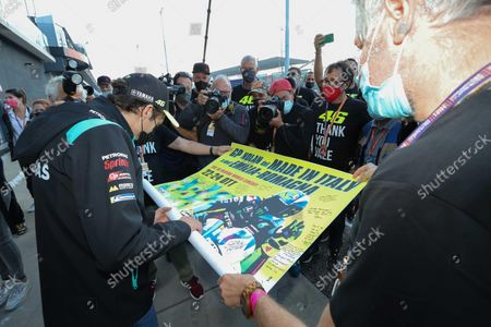 Valentino Rossi (L) of Petronas Yamaha SRT is presented with the official poster of the Motorcycling Grand Prix of Italy and Emilia-Romagna by members of the media at Misano World Circuit 'Marco Simoncelli' at Misano Adriatico, Rivieria di Rimini, Italy, 22 October 2021. The Motorcycling Grand Prix of Italy and Emilia-Romagna takes place on 24 October 2021.