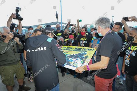 Valentino Rossi (C, front) of Petronas Yamaha SRT is presented with the official poster of the Motorcycling Grand Prix of Italy and Emilia-Romagna by members of the media at Misano World Circuit 'Marco Simoncelli' at Misano Adriatico, Rivieria di Rimini, Italy, 22 October 2021. The Motorcycling Grand Prix of Italy and Emilia-Romagna takes place on 24 October 2021.