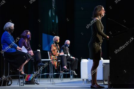 Michele Rosenthal, right, gives opening remarks at the Eradicate Hate Global Summit in Pittsburgh. Rosenthal's brothers, Cecil and David Rosenthal, were killed in the Oct. 27, 2018, mass shooting at the Tree of Life synagogue. Seated from left are Kathleen Blee, Lorrie Cranor, Laura Ellsworth and Rabbi Hazzan Jeffrey Myers, who also gave opening remarks at the summit