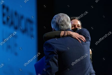 Stock Photo of Mark Nordenberg, left, gives Michele Rosenthal a hug as she prepares to give opening remarks at the Eradicate Hate Global Summit in Pittsburgh. Rosenthal's brothers, Cecil and David Rosenthal, were killed in the Oct. 27, 2018, mass shooting at the Tree of Life synagogue. Nordenberg was a co-chiar of the summit