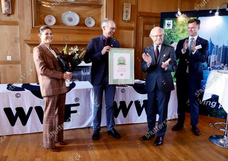 Stock Picture of Crown Princess Victoria and King Carl Gustaf attend the WWF's annual meeting. King Carl Gustaf gives the Environmental Hero