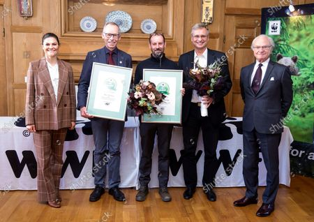 Stock Image of Crown Princess Victoria and King Carl Gustaf attend the WWF's annual meeting. King Carl Gustaf gives the Environmental Hero of the Year to professor Johan Rockstrom and the Swedish Bird Assessment project Ake Lindstrom and Martin Green at Lund University.