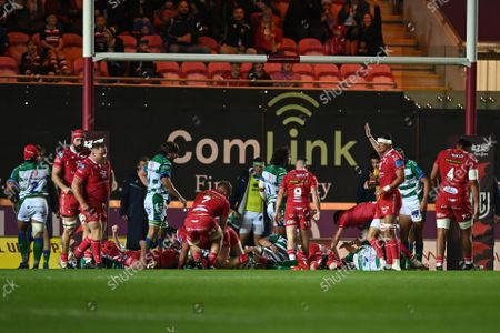 Stock Image of Scarlets vs Benetton Rugby. Rob Evans of Scarlets scores his side's first try