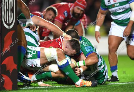 Stock Picture of Rob Evans of Scarlets powers over to score try.