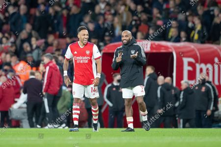 Pierre-Emerick Aubameyang of Arsenal FC and Alexandre Lacazette of Arsenal FC share a joke at full time