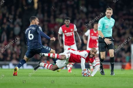 Douglas Luiz of Aston Villa FC foul Alexandre Lacazette of Arsenal FC