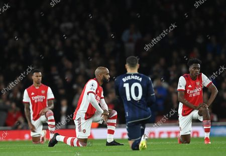 Alexandre Lacazette (C-L) of Arsenal takes the knee during the English Premier League match between Arsenal London and Aston Villa in London, Britain, 22 October 2021.