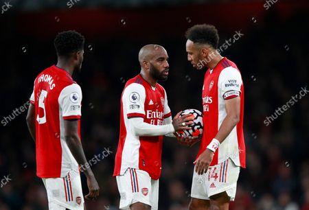 Arsenal's Alexandre Lacazette, center, speaks with Arsenal's Pierre-Emerick Aubameyang, right, during the English Premier League soccer match between Arsenal and Aston Villa at the Emirates stadium in London