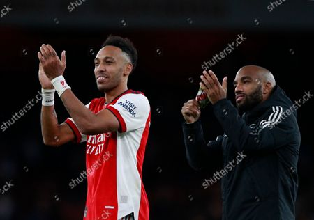 Arsenal's Pierre-Emerick Aubameyang, left, and Arsenal's Alexandre Lacazette celebrate at the end of the English Premier League soccer match between Arsenal and Aston Villa at the Emirates stadium in London