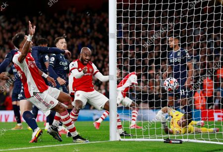 Arsenal's Pierre-Emerick Aubameyang, left, and Arsenal's Alexandre Lacazette, center, celebrate after Thomas Partey scores his side's opening goal during the English Premier League soccer match between Arsenal and Aston Villa at the Emirates stadium in London