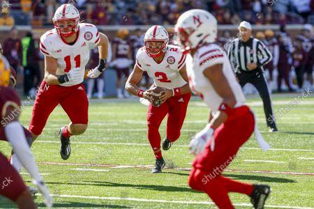 Nebraska quarterback Adrian Martinez (2) rushes with tight end Austin Allen (11) against Minnesota in an NCAA college football game, in Minneapolis