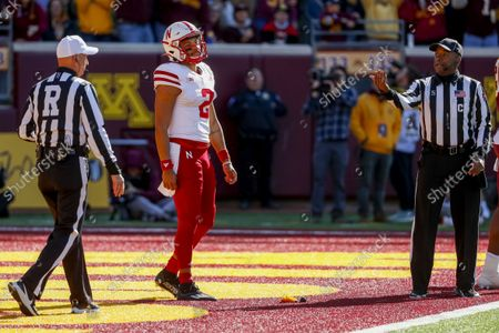 Stock Picture of Nebraska quarterback Adrian Martinez (2) reacts to the officials' penalty call for intentionally grounding the ball in the end zone resulting in a safety in the fourth quarter of an NCAA college football game, in Minneapolis. Minnesota won 30-23