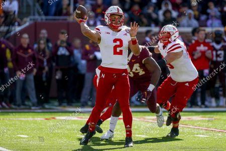 Stock Image of Nebraska quarterback Adrian Martinez (2) passes against Minnesota in an NCAA college football game, in Minneapolis