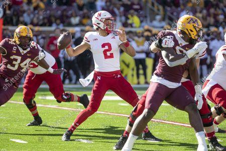 Nebraska quarterback Adrian Martinez (2) passes against Minnesota in the first quarter of an NCAA college football game, in Minneapolis