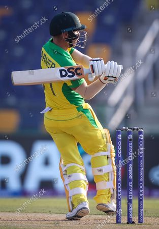 Australia's David Warner hits a boundary  during the ICC Men's T20 World Cup cricket match between Australia and South Africa at Sheikh Zayed Cricket Stadium in Abu Dhabi, UAE, 23 October 2021.