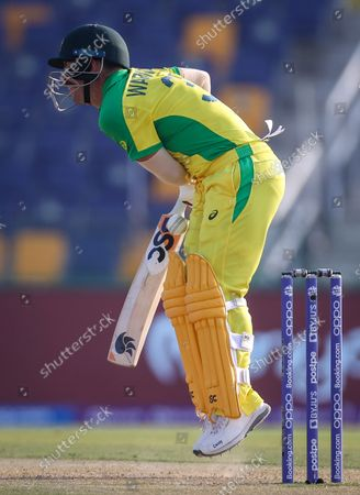 Australia's David Warner reacts after being hit by a delivery during the ICC Men's T20 World Cup cricket match between Australia and South Africa at Sheikh Zayed Cricket Stadium in Abu Dhabi, UAE, 23 October 2021.