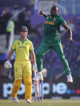 South Africa's Kagiso Rabada (R) reacts after dismissing Australia's David Warner during the ICC Men's T20 World Cup cricket match between Australia and South Africa at Sheikh Zayed Cricket Stadium in Abu Dhabi, UAE, 23 October 2021.
