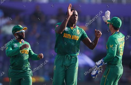 South Africa's Kagiso Rabada (C) reacts after dismissing Australia's David Warner during the ICC Men's T20 World Cup cricket match between Australia and South Africa at Sheikh Zayed Cricket Stadium in Abu Dhabi, UAE, 23 October 2021.