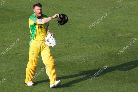 Australia's David Warner reacts as he leaves the field after he was dismissed during the Cricket Twenty20 World Cup match between South Africa and Australia in Abu Dhabi, UAE