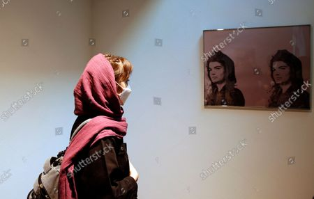 A visitor looks at 'Jacqueline Kennedy' portraits by US artist Andy Warhol, on display in the exhibition 'Persona' at the Tehran Museum of Contemporary Art, in Tehran, Iran, 23 October 2021. The show dedicated to Warhol will run until 24 October 2021.