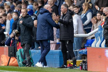 Peterborough United Manager Darren Ferguson (right ) & Queens Park Rangers Manager Mark Warburton shake hans at the start of the the EFL Sky Bet Championship match between Peterborough United and Queens Park Rangers at London Road, Peterborough