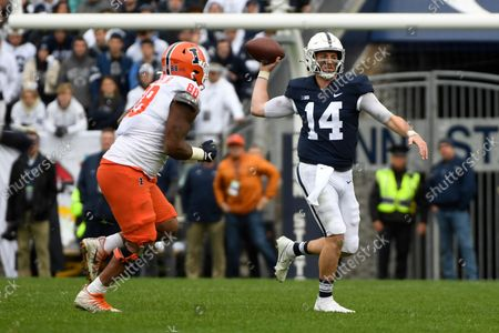 Stock Image of Penn State quarterback Sean Clifford (14) looks to throw while being pursued by Illinois defensive lineman Keith Randolph Jr. (88) during an NCAA college football game in State College, Pa. on