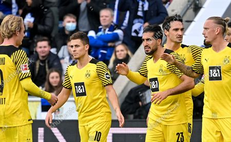 Dortmund's Emre Can (CR) celebrates with his teammates after scoring the 1-0 lead from the penalty spot during the German Bundesliga soccer match between DSC Arminia Bielefeld and Borussia Dortmund in Bielefeld, Germany, 23 October 2021.