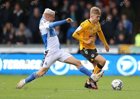 Stock Photo of Jake Cain of Newport County is challenged by Luke Thomas of Bristol Rovers.
