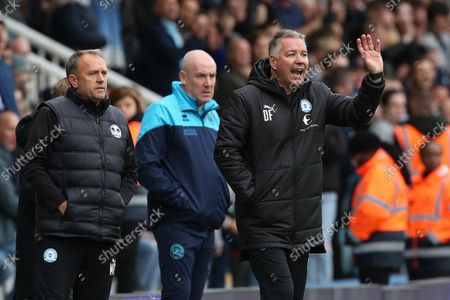 Peterborough United Manager Darren Ferguson issues instructions from the touchline alongside Queens Park Rangers Manager Mark Warburton