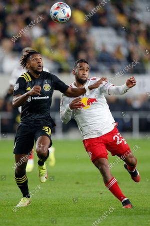 Columbus Crew's Steven Moreira, left, and New York Red Bulls' Cristian Casseres chase the ball during the first half of an MLS soccer match, in Columbus, Ohio